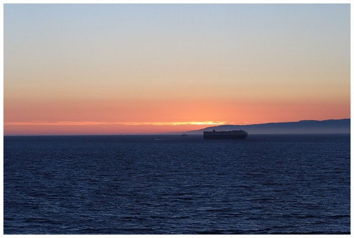 Sunset in the Juan de Fuca Straits; a car-carrier eastbound for Seattle/Tacoma