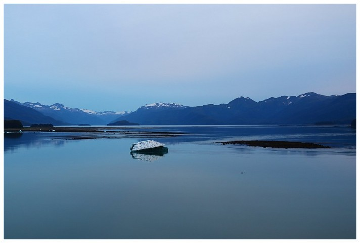 Low tide at Tracy Arm bar and an iceberg aground in the shallow water