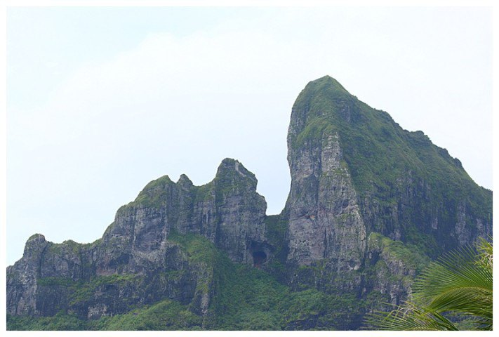 Towering above us, the volcanic peaks of the island