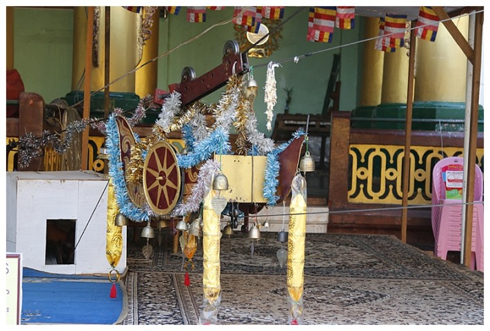 Offerings ($) go into this 'cart' and it is sent, by a cable car, into the pagoda dome