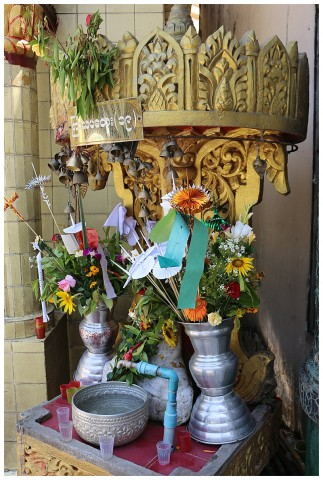 Flowers and articles placed by worshippers