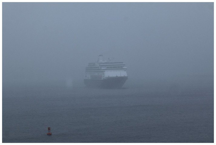 The Zaandam approaching her berth as she comes through the wind and rain
