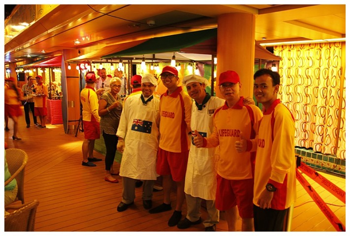 "The party theme was ""Australian Beach party', some of our crew, in Lifeguard uniform"