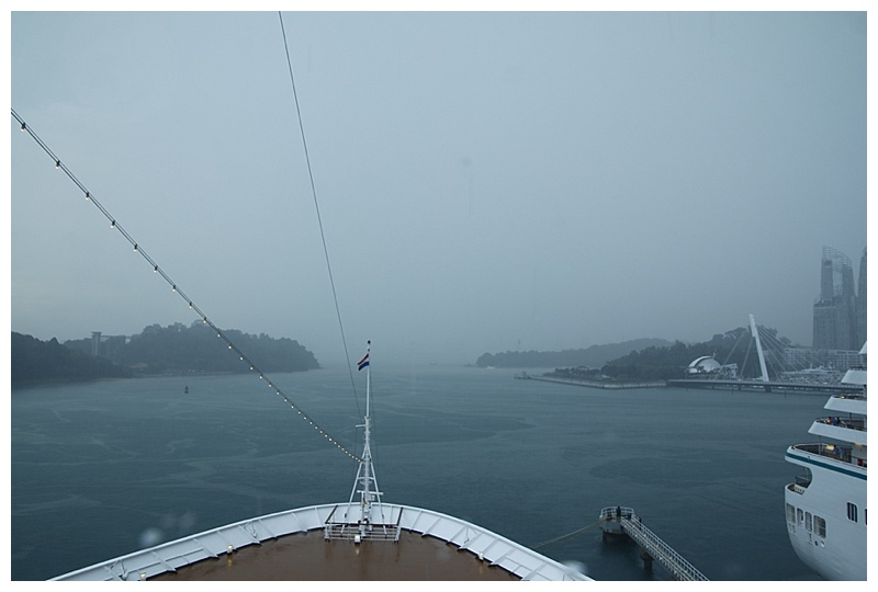 Having swung in Cruise Bay, we back in during heavy rain