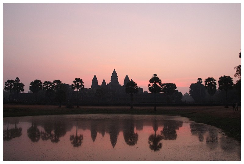 Silhouetted by the rising sun,the 5 towers cast their shadows onto the sacred pond.