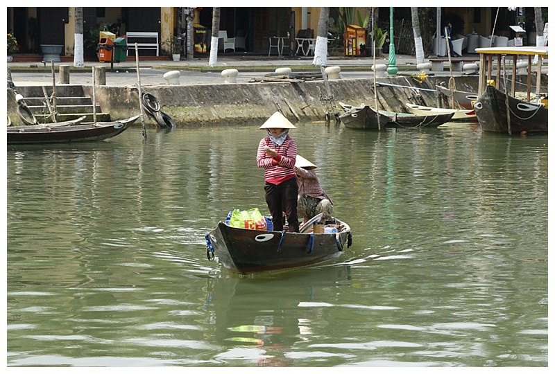 On the Bon River, a lady takes her shopping across