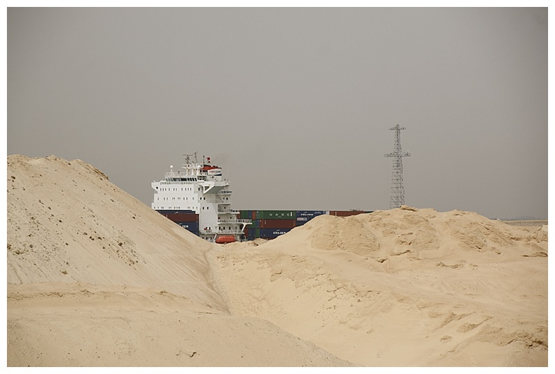 A southbound container-ship over the sand hills, the dredge from the new channel.