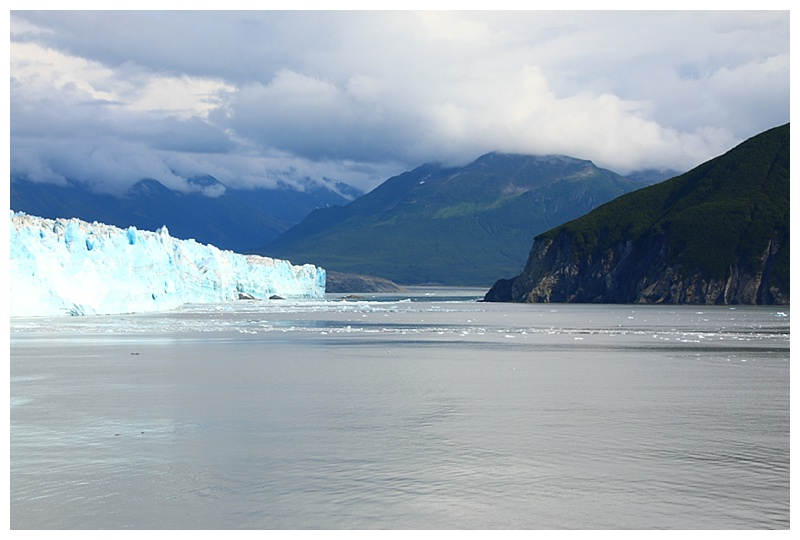 Stopped off the face, the opening to Russell Fjord; the ice has reached the land to the right on several occasions, acting like a dam, the fjord has flooded until, eventually, the ice breaks and a wall of water thunders into Disenchantment Bay