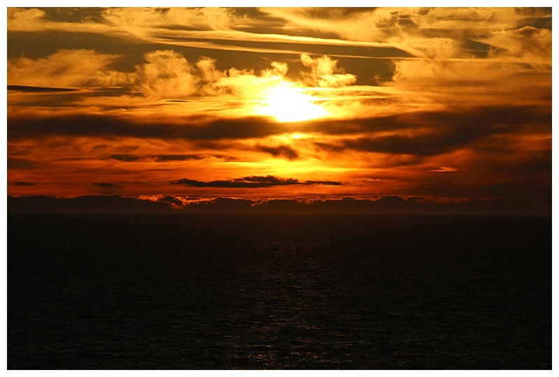 Sunset in the Hecate Straits, the Queen Charlotte Islands in the distance.